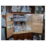 Bar cabinet full of Waterford