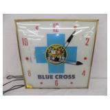 15X15 BLUE CROSS PAM CLOCK
