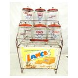 6 JAR LANCE RACK W/SIGN & JARS