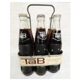6 PACK METAL TAB CARRIER W/BOTTLES