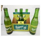 6 PACK UPPER 10 W/BOTTLES