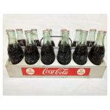 12  PACK ALUM COKE CARRIER W/BOTTLES