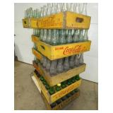 SEVERAL COCA COLA CRATES AND BOTTLES
