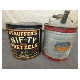 PRETZELS TIN AND AN OLD STOCK GAS CAN