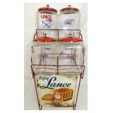 LANCE RACK W/ JARS AND SIGN