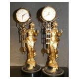PAIR OF EARLY VICTORIAN FIGURAL SWINGER CLOCKS