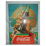 24X33 COKE SIGN W/ BOTTLE AND WORLD
