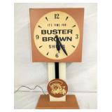 12X27 BUSTER BROWN ELE. CLOCK W/ PENDULUM