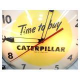 VIEW 2 CLOSE UP CATEPILLAR TIME TO BUY CLOCK