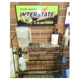 INTERSTATE BATTERY RACK W/SIGN