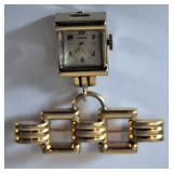 Gold lapel watch