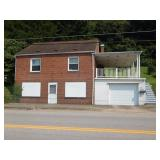 Multi-Use Building Sold to the Highest Bidder