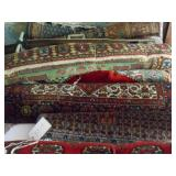 Twelve hand woven rugs various sizes