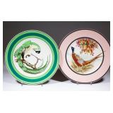 Two plates designed by famous Buffalo Pottery employee Ralph Stuart, one signed and hand-painted...
