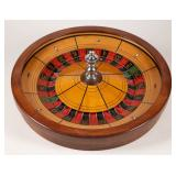 Antique roulette wheel and table