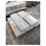 "10 pcs of grey 4"" thick sloped wal..."