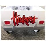 Vintage White Metal Huskers Car