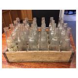 Wood Tote Full of Soda Bottles