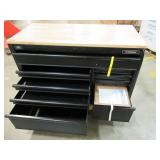 Husky 52 in. x 24.5 in. D 9-Drawer Mobile Workbench with Adjustable Height Solid Wood Top in Matte Black, HOLC5209BB1M. - Dropped on RH Side.