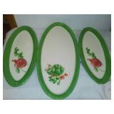 3 matching ceramic serving trays.