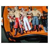 (23) Wrestling Figurines and a Trunki Ride on Suit Case