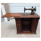 Antique 1905 Singer Sewing Machine and Treadle in Ornate Oak Cabinet