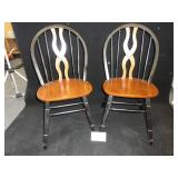 Two Wood Chairs with Decorative Spine