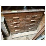Wood cabinet plump full of upholstery stuff