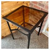 Black Metal Accent Table with a Glass Top