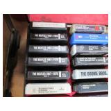 Assorted Eight-Track tapes in a cas...
