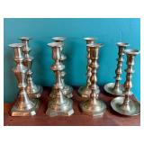 Four Sets of Brass Candle Holders