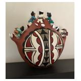 Signed Native American Storytellers pottery
