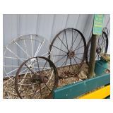 Several Iron Wagon Wheels