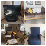 Flat Screen TV with Black Stand,  Blue Recliner, Wood Misson sofa and chair with ottoman