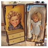 VINTAGE Composition Shirley Temple Doll in Case with Clothes Located Inside – Auction Estimate $50-$