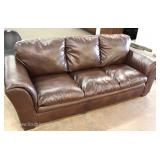 Contemporary Leather Style Plush Sofa Located Inside – Auction Estimate $200-$400