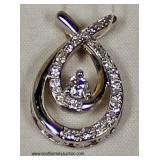 10 Karat White Gold Pendant with approximately .25 Diamonds – auction estimate $200-$400