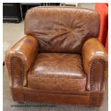 Leather Tooled Club Chair – auction estimate $200-$400