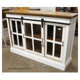 White Distressed Industrial 3 Sliding Door Media Cabinet  Auction Estimate $300-$600 – Located Insi