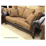 NEW Leather and Upholstery Loveseat with Throw Pillows  Auction estimate $200-$400 – Located Inside