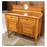 Oak 2 Drawer 2 Door Server with Mirror Back Splash  Auction Estimate $100-$300 – Located Inside