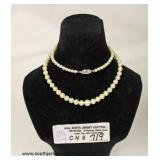 Marked 14 Karat White Gold Clasp Pearl Necklace  Auction Estimate $50-$100 – Located Inside