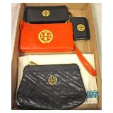 Box Lot of Tory Burch (?) Wallets, Wristlets, and Purse  Auction Estimate $50-$100 – Located Inside