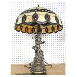 Leaded Glass Shade Cherub Figure Base Lamp  Auction Estimate $100-$300 – Located Inside