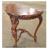 SOLID Mahogany Hand Carved Figural Half Moon Table  Auction Estimate $100-$300 – Located Inside