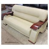 NEW Ultra Modern Leather Sofa with Lacquer Mahogany Arms and Legs  Auction Estimate $300-$600 – Loc