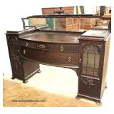 Early 20th Century Mahogany Double Curio Mirrored Back Buffet  Auction Estimate $300-$600 – Located