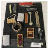 Tray Lot of Lighters, Pen Knives, Spoon and Napkin Ring  Auction Estimate $20-$50 – Located Inside