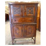 Depression Walnut and Oak Blind Door China Cabinet  Auction Estimate $100-$300 – Located Inside