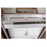 VINTAGE Rock-Ola Jukebox with some 45 RPM Records  Auction Estimate $100-$500 – Located Dock